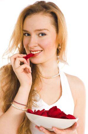 The beautiful blonde eats pink petals photo