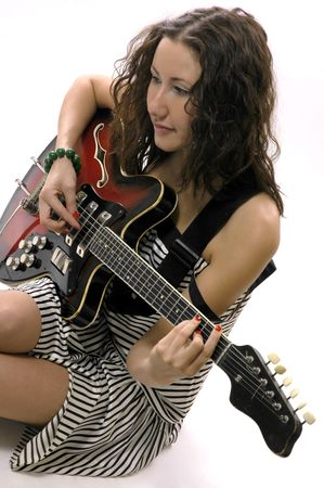 The nice girl plays on a guitar photo