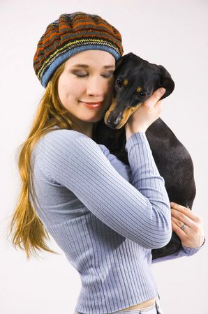The girl the teenager and a dog