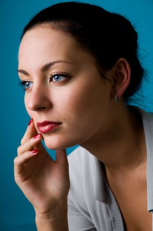 The woman on a dark blue background close up