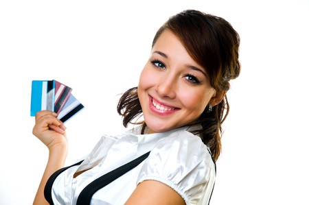The smiling girl with credit cards in a hand photo