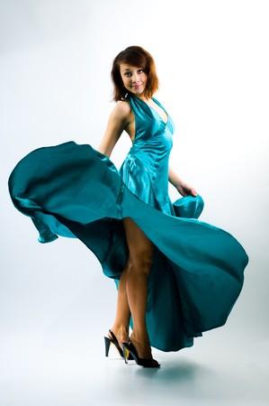 beautiful girl dancing in the ballroom dress