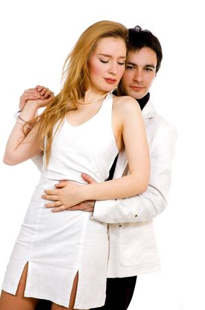 The pair embraces in white clothes photo