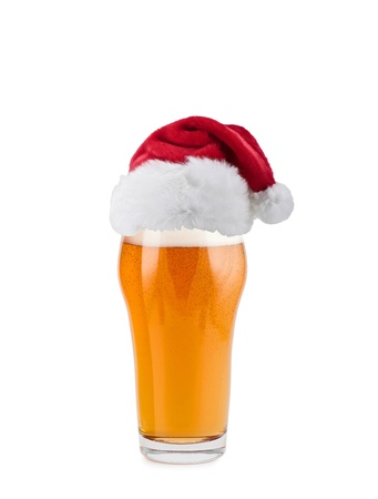 brew beer: Sombrero de Pap� Noel con la cerveza Foto de archivo