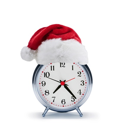 alarm clock with christmas santa hat photo