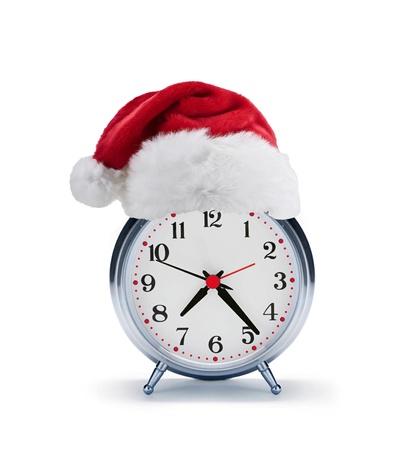 alarm clock with christmas santa hat photo