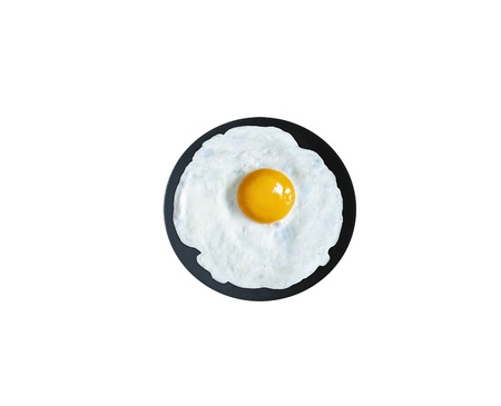 Fried Egg in a frying pan isolated on white, top view photo