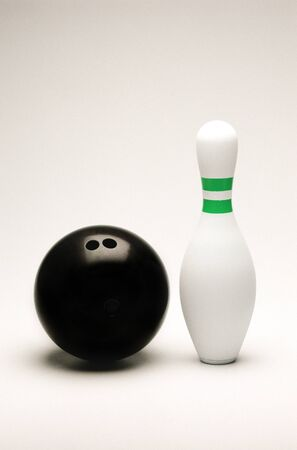 Bowling ball and pin isolated on white photo
