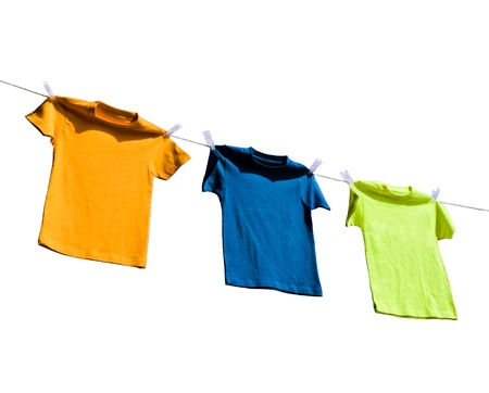 Photograph of four blank t-shirts photo