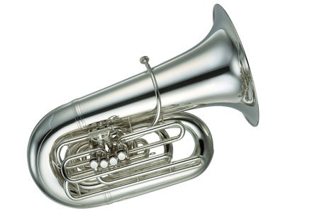 Large gold brass tuba on white background