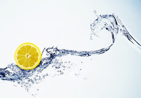 lemon in spray of water  photo