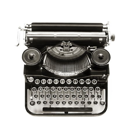 type: Antique typewriter against a crisp white backdrop. Stock Photo