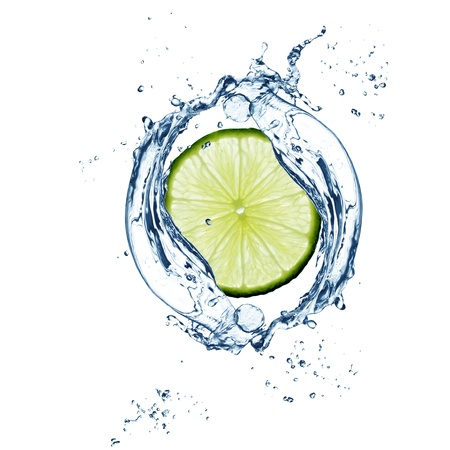 Slice of  lime in water splash - excellent quality photo