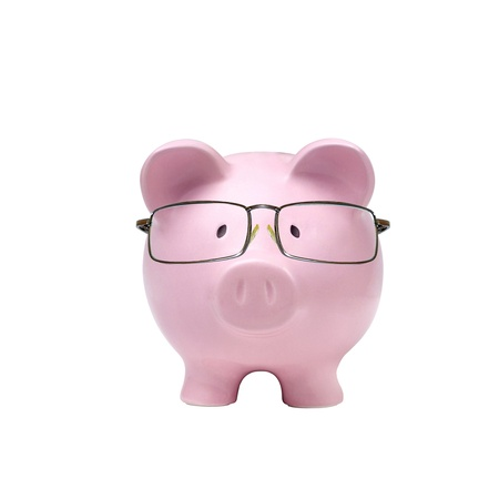 piggy bank with glasses in isolated white background photo