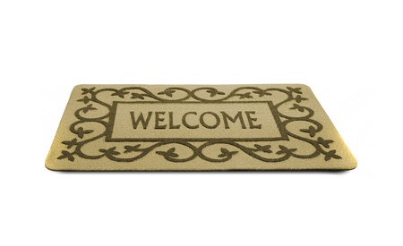 Photo of a welcome door mat isolated on a white background. photo