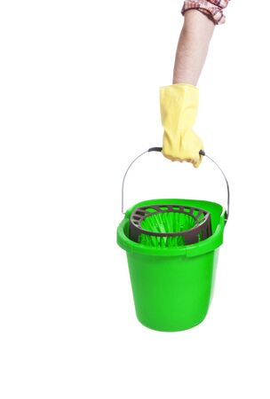 Human hand holding empty plastic bucket container photo