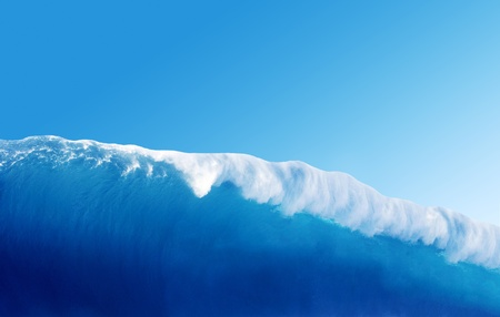 Large Blue Surfing Wave Breaks in the Ocean photo