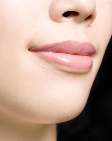 Young woman's glossy pink lips-copyspace Stock Photo - 13657230