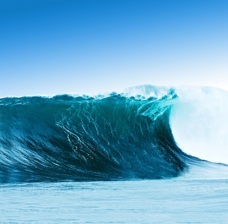 Large surfing wave breaks in the ocean Stock Photo