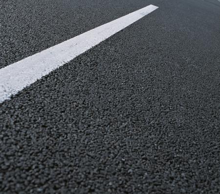 asfalt road close up isolated on grey background photo