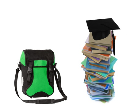 Student hat on books and bag