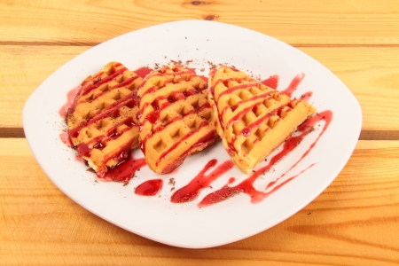 Waffles with strawberry on wooden table photo