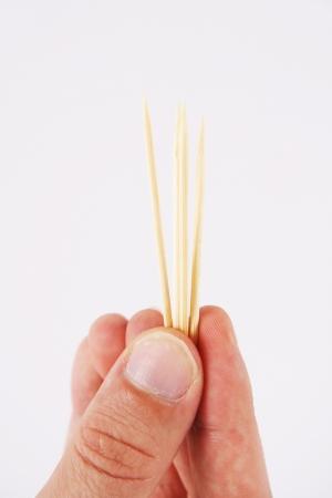 toothpick: toothpicks and hand