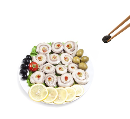 fish slices served with tomato and olives, and lemon photo