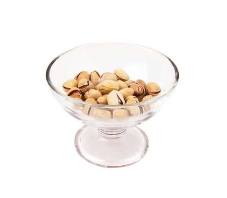 pistachio nuts in a glass bowl photo