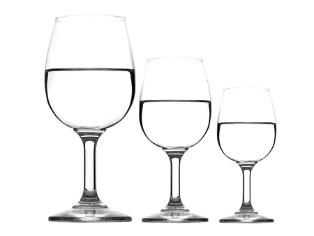 glass half full: Three wine glasses with water isolated on white