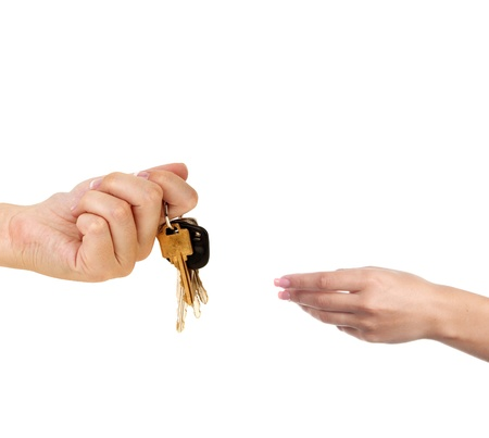 Human hands and key isolated photo