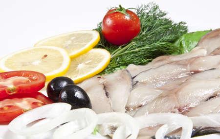 sprat: macro picture of fillet herring with vegetables
