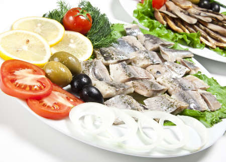 fish slices served with tomato and olives photo