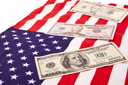 dollars on american flag photo