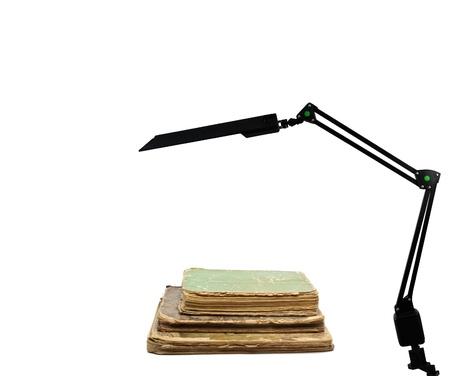 Retro book and modern lamp photo