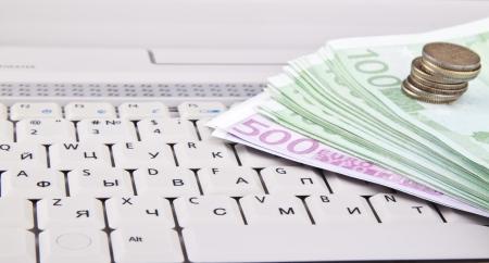 e auction: money on keyboard