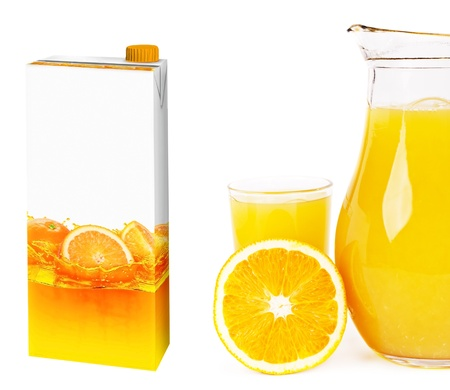cartons: Fresh orange juice in a glass
