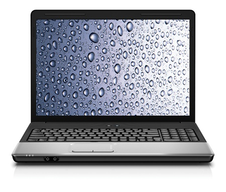 notebook with water drops wallpaper isolated on white photo