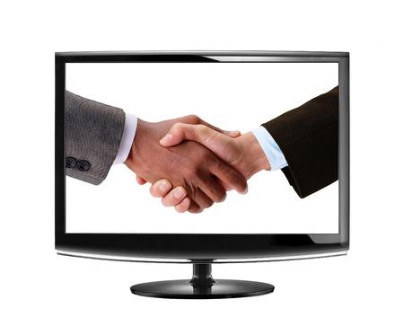 handshake in LCD monitor photo