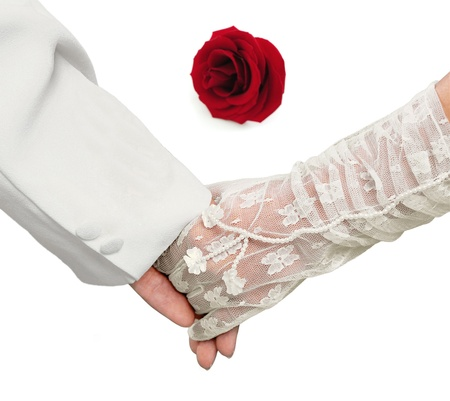 Close-up Holding Hands with red rose photo