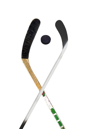 Hockey stick and puck on white photo