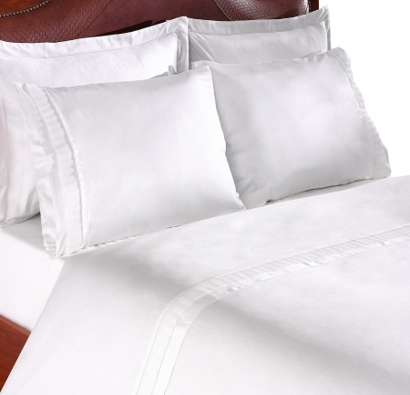close up picture of two pillows on a sofa photo