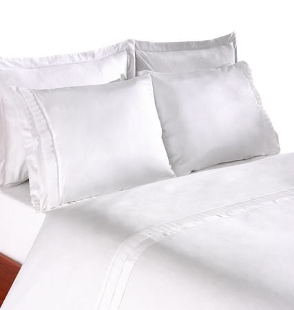 bed linen: bedding with several pillows