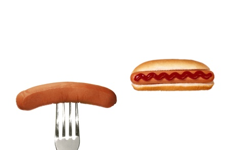 Grilled hot dog with sausage on fork photo