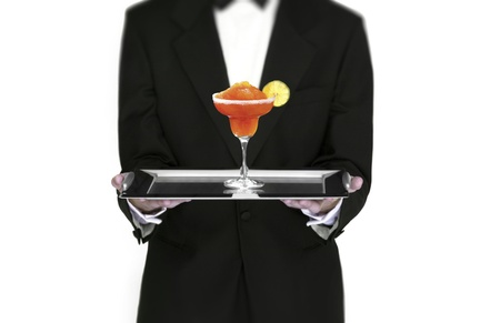 Waiter holding cocktail on silver tray photo