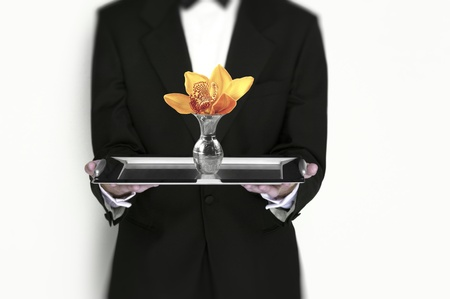 Waiter holding flower on silver tray photo