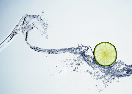 lime in spray of water can be used as background photo