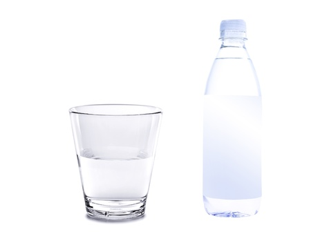 water in plastic bottle with glass isolated on white background photo