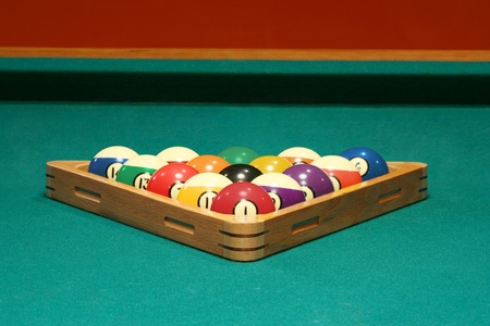 Racked balls set for a game of 8 ball photo