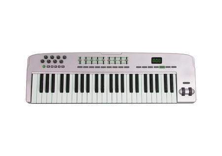 Music keyboard isolated on white photo